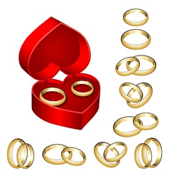 set of gold wedding rings with heart-shaped box vector image vector image
