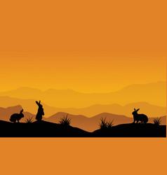 Silhouette of bunny on desert landscape vector
