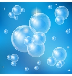 Soap bubbles on a blue background vector
