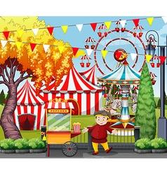 Man selling popcorn at the amusement park vector image vector image