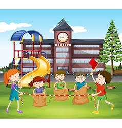 Children jumping sacks at school vector image