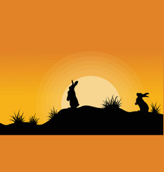 silhouette of bunny on the hill at sunset vector image vector image
