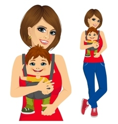 Mother holding little boy with baby carrier vector