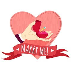 Hand holding wedding ring in a box heart shape vector