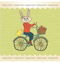 Easter bunny with a basket of easter eggs vector