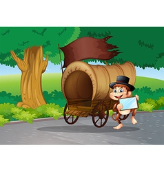 A monkey at the street standing beside the wagon vector image vector image
