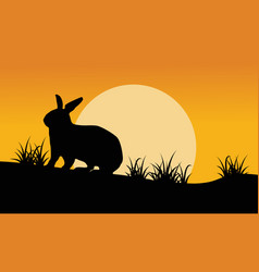 Silhouette of bunny and grass at sunset vector