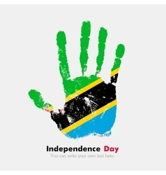 Handprint with the flag of tanzania in grunge vector