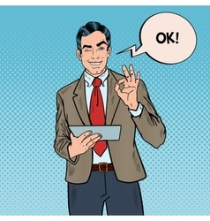 Pop Art Businessman with Tablet Gesturing OK vector image