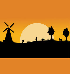 Landscape of bunny and windmill silhouettes vector