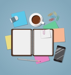Notebook open with coffee vector
