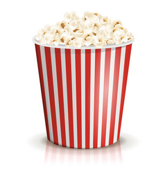 A full red-and-white striped bucket of popcorn vector