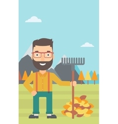 Man with rake standing near heap of autumn leaves vector