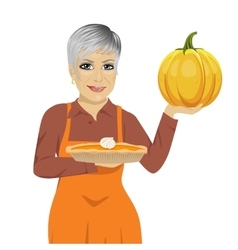 Senior woman holding freshly baked pumpkin pie vector