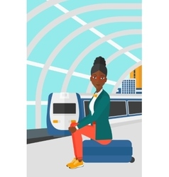 Woman sitting on railway platform vector