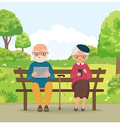 Elderly couple in the park with gadgets vector image vector image