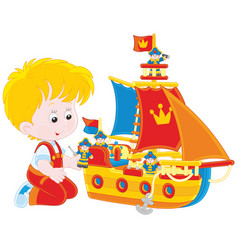 Boy playing a toy ship vector