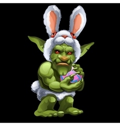Funny green troll in bunny suit with ball vector