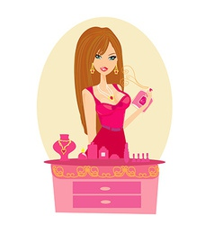 Young woman spraying perfume on herself vector