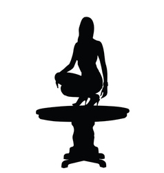 Woman on table silhouette vector