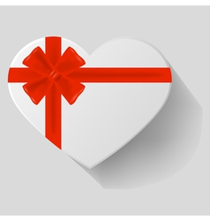 Heart-shaped gift with red bow vector image