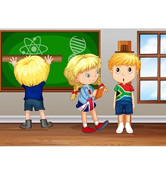 Children writing on board in classroom vector