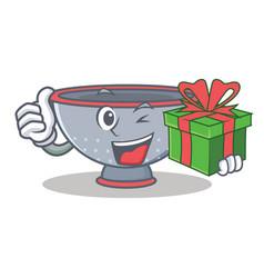 With gift colander utensil character cartoon vector
