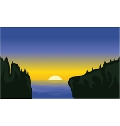 Silhouette of cliff in the sea vector