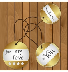 Shiny gold gift round tags for gifts on wooden vector