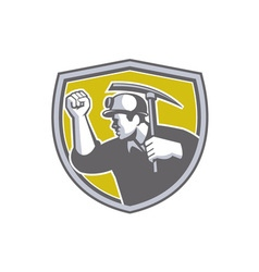 Coal miner clenched fist pick axe shield retro vector