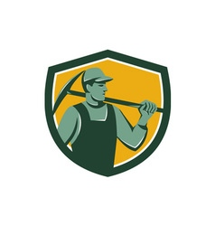 Coal miner with pick axe shield retro vector