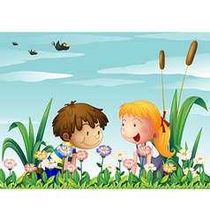 A cute girl and a cute boy watching the flowers vector image vector image