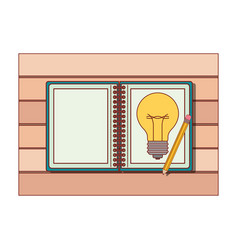 spiral notebook with light bulb in sheet and vector image