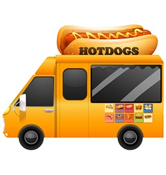 Yellow food truck with giant hotdogs vector