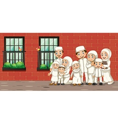 Muslim family in white costume vector image vector image