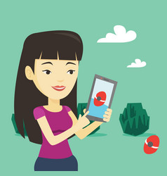 woman playing action game on smartphone vector image