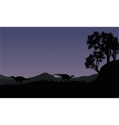 Silhouette of two iguanodon vector