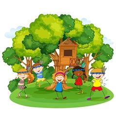 Children playing red indians in the garden vector