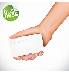 Hand holding name card vector