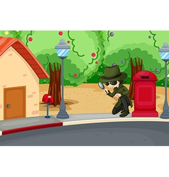 A detective at the road with a magnifying lens vector