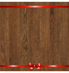 Wood background with red bow vector