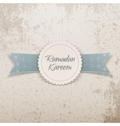Ramadan kareem paper emblem with greeting ribbon vector
