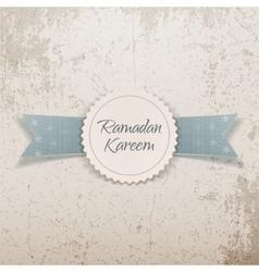 Ramadan kareem paper emblem with greeting ribbon vector
