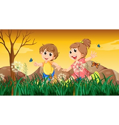 A girl and a boy playing with the butterflies vector image