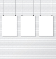 Three white poster on brick wall vector image vector image