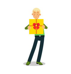 young smiling blonde man standing with yellow gift vector image