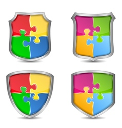 Shields with puzzle pieces vector image