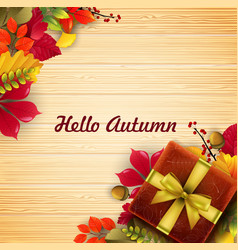 autumn leaves gift box with ribbon and bow vector image vector image