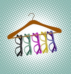 Glasses hanging on a hanger vector