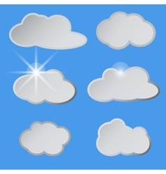 Stylized white clouds in the blue sky the sun vector